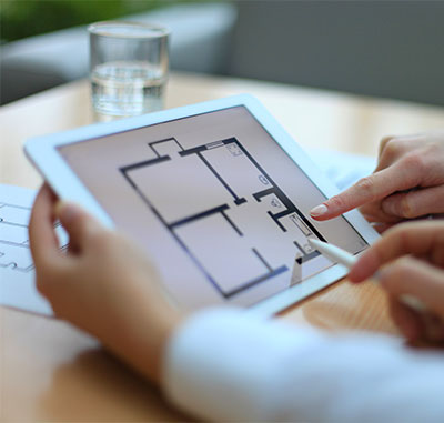 looking at house plans on tablet