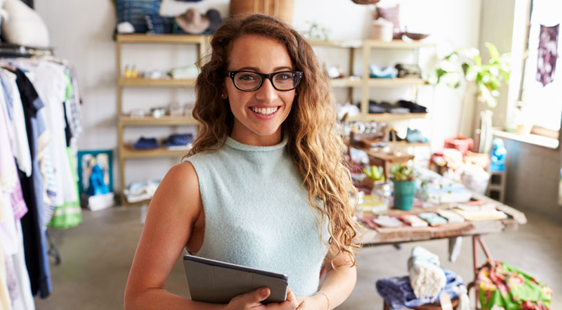 your guide to drafting business terms and conditions young business woman smiling in her store