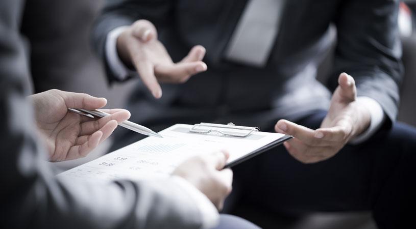 businessmen discussing shareholder agreements